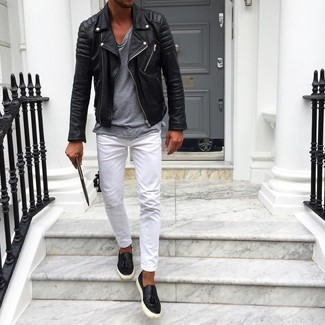 How to wear: black leather biker jacket, grey crew-neck t-shirt, white chinos, black leather slip-on sneakers