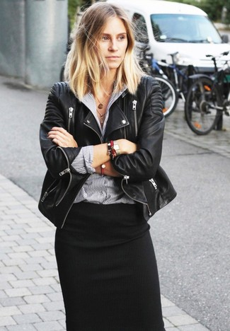 A black leather biker jacket and a black midi skirt is a smart combo to add to your styling repertoire. Keep the autumn anxiety at bay in a killer ensemble like this one.
