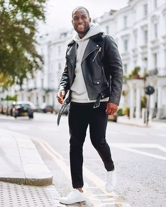 Black Jeans Spring Outfits For Men: If the setting allows off-duty styling, go for a black leather biker jacket and black jeans. As for footwear, introduce white canvas low top sneakers to the equation. With the departure of snow come warmer days and the need for a cool outfit just like this one.