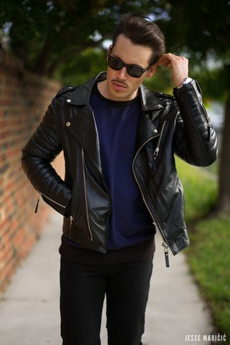 Reach for a black leather motorcycle jacket and black jeans to bring out the stylish in you. No doubt, an ensemble like this will keep you warm and stylish all season long.