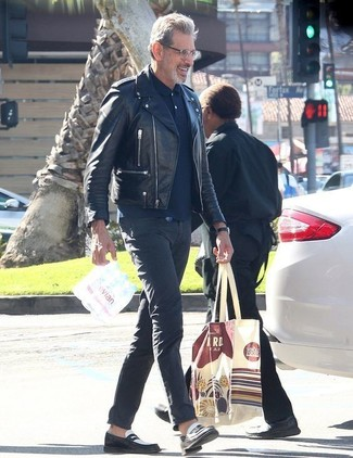 How to wear: black leather biker jacket, navy polo, charcoal chinos, black and white leather loafers