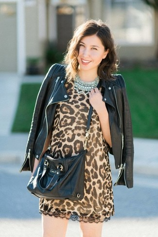 Black Leather Biker Jacket Outfits For Women: This is undeniable proof that a black leather biker jacket and a tan leopard shift dress look amazing when combined together in a relaxed ensemble.