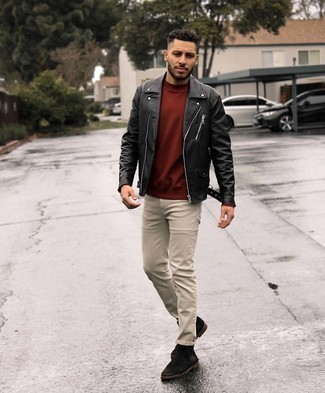 500+ Chill Weather Outfits For Men: For relaxed dressing with a clear fashion twist, you can always rely on a black leather biker jacket and beige jeans. To give your overall look a more refined finish, add dark brown suede desert boots to the equation.
