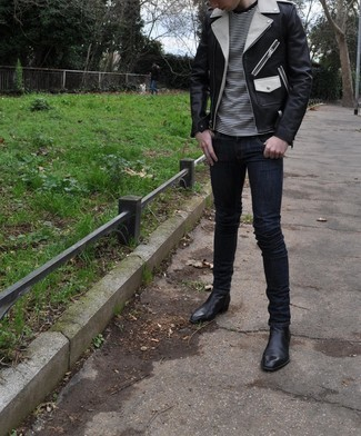 Navy Skinny Jeans Outfits For Men: A black leather biker jacket and navy skinny jeans make for the perfect base for a casually dapper getup. Boost the dressiness of this outfit a bit by rocking a pair of black leather chelsea boots.