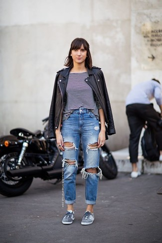 If you lovestaying-in clothes which are stylish enough to wear out, you should try this combination of a black leather motorcycle jacket and blue ripped boyfriend jeans. For shoes, go down the classic route with grey suede low top sneakers. There's nothing like a cool outfit to brighten up a dreary autumn afternoon.