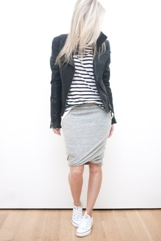 A black leather moto jacket and a grey pencil skirt will showcase your sartorial self. For footwear go down the casual route with white low top sneakers.