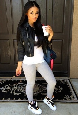 How to wear: black leather biker jacket, white and black print tank, grey leggings, white high top sneakers