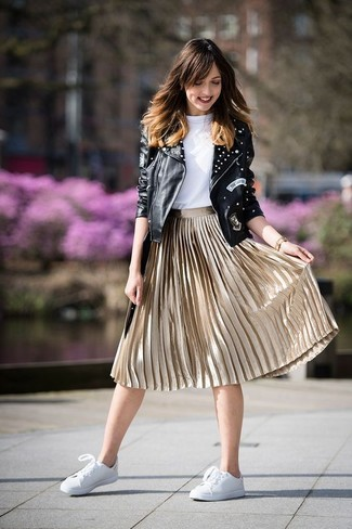 How to wear: black studded leather biker jacket, white crew-neck t-shirt, gold pleated midi skirt, white leather low top sneakers