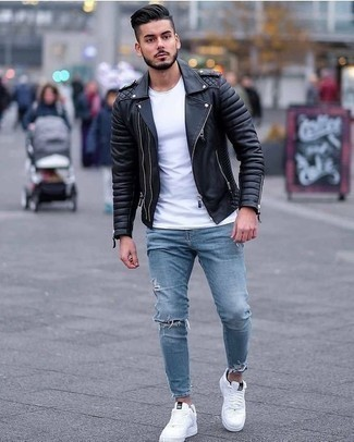 How to Wear Light Blue Ripped Skinny Jeans For Men: To pull together a laid-back menswear style with a twist, you can easily dress in a black leather biker jacket and light blue ripped skinny jeans. Go ahead and complete this ensemble with white canvas low top sneakers for a touch of elegance.