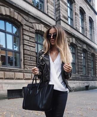 How to wear: black leather biker jacket, white silk long sleeve blouse, black skinny jeans, black leather tote bag
