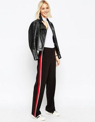 How to wear: black leather biker jacket, white short sleeve sweater, red and black wide leg pants, white and black low top sneakers