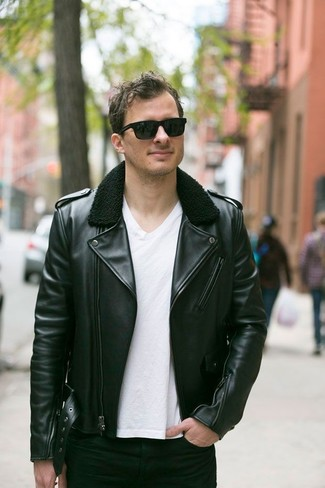 A black leather biker jacket and black slim jeans is a good combination to carry you throughout the day. This getup is super functional and will help you out in transeasonal weather.