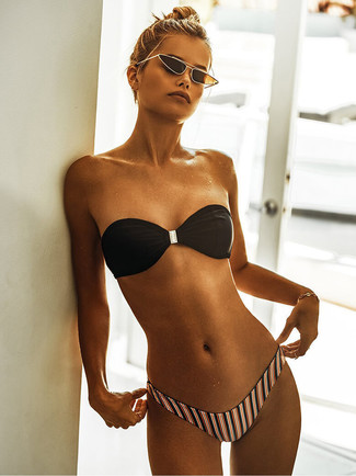 How to wear: black bikini top, multi colored vertical striped bikini pant, black and gold sunglasses, gold bracelet