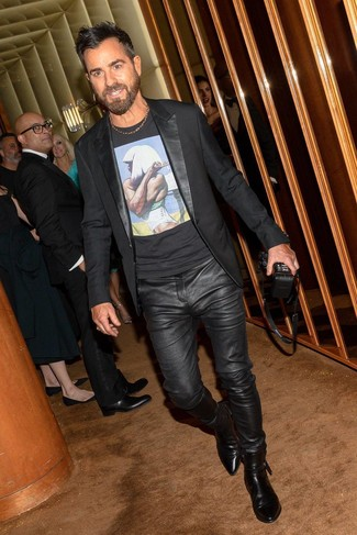 How to wear: black blazer, black print crew-neck t-shirt, black leather jeans, black leather chelsea boots