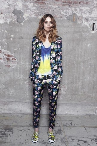 How to wear: black floral blazer, blue print v-neck t-shirt, black floral skinny pants, yellow slip-on sneakers
