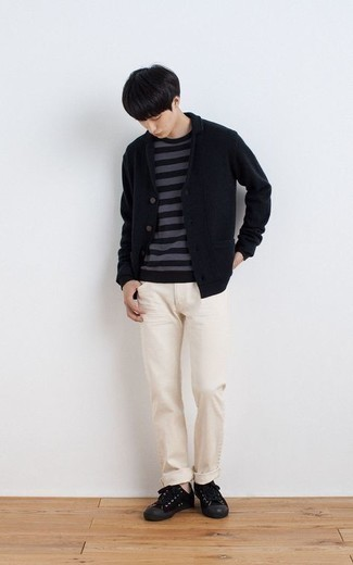 Black Knit Blazer Outfits For Men: For a goofproof laid-back option, you can always rely on this pairing of a black knit blazer and beige jeans. Want to break out of the mold? Then why not introduce black canvas low top sneakers to the mix?