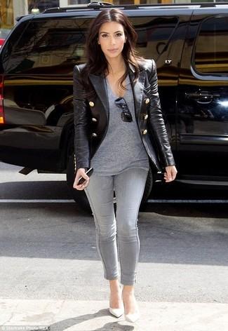 Kim Kardashian wearing Black Leather Blazer, Grey V-neck T-shirt, Grey Skinny Jeans, White Leather Pumps
