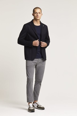 Black Blazer Outfits For Men: This combo of a black blazer and grey jeans looks neat and instantly makes you look seriously stylish. When this look is just too much, play it down by slipping into white and brown athletic shoes.
