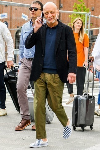 How to Wear Olive Chinos: For an effortlessly smart getup, try pairing a black wool blazer with olive chinos — these two pieces fit nicely together. And if you need to instantly play down this ensemble with one single item, introduce blue check canvas slip-on sneakers to this look.