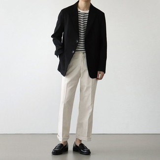 Black Blazer Outfits For Men: This combo of a black blazer and white dress pants is the picture of polish. If not sure as to what to wear when it comes to footwear, go with black leather loafers.