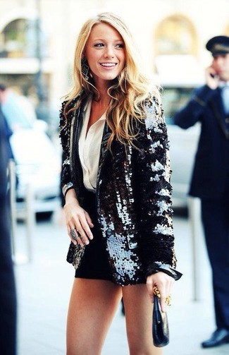 Pairing a black sequin blazer with black shorts is a comfortable option for running errands in the city.
