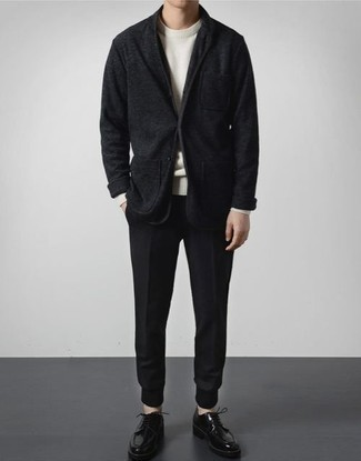 Black Knit Blazer Outfits For Men: For a look that's city-style-worthy and effortlessly neat, team a black knit blazer with navy chinos. A pair of black leather derby shoes immediately revs up the classy factor of any outfit.