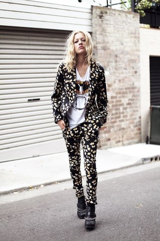 A black floral blazer and black floral skinny pants is a good combination to carry you throughout the day. Perk up your outfit with black chunky leather ankle boots. This look is a savvy option come warmer days.