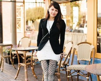 Deena Varshavskaya wearing Black Blazer, White Polka Dot Tunic, Black and White Print Leggings