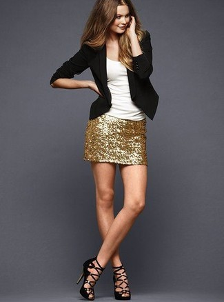 A black blazer jacket and a gold sequin mini skirt are great staples that will integrate perfectly within your current looks. Elevate your getup with black suede heeled sandals.