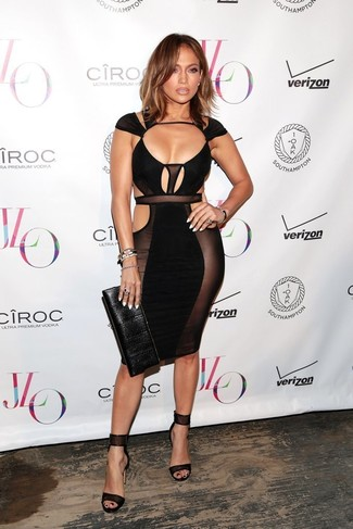 Jennifer Lopez wearing Black Cutout Bodycon Dress, Black Leather Heeled Sandals, Black Leather Clutch, Black Bracelet