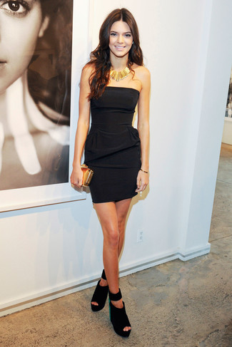 Kendall Jenner wearing Black Bodycon Dress, Black Suede Wedge Sandals, Gold Clutch, Gold Necklace