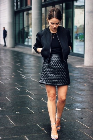 Reach for a black bomber jacket and a black quilted leather mini skirt to create a great weekend-ready look. Let's make a bit more effort now and throw in a pair of metallic leather heeled sandals.