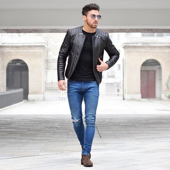 A black leather bomber jacket and blue slim jeans is a great combination to  add to