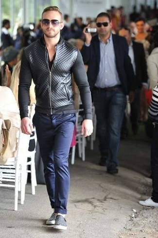 How to wear: black quilted leather bomber jacket, black v-neck t-shirt, navy chinos, black leather slip-on sneakers