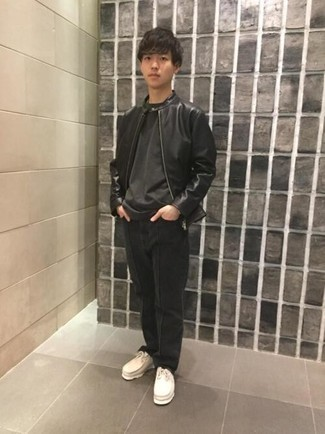 Black Leather Jacket with Black Jeans Outfits For Men: A black leather jacket and black jeans are an essential pairing for many trendsetting gentlemen. Choose a pair of beige suede desert boots and the whole ensemble will come together wonderfully.