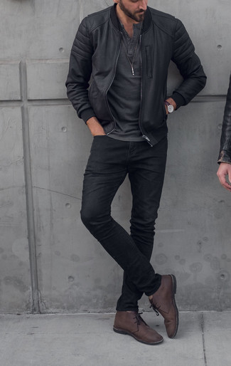A charcoal henley shirt and black jeans is a great combination to carry you throughout the day. Complement this look with dark brown leather desert boots.