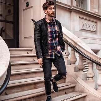 Black Quilted Leather Bomber Jacket Outfits For Men: Pair a black quilted leather bomber jacket with black ripped jeans if you're looking for an outfit option that is all about bold casual style. Finishing off with black and white athletic shoes is a fail-safe way to inject a more laid-back touch into this ensemble.