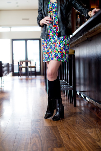 Black Leather Ankle Boots Outfits: This casual combo of a black leather bomber jacket and a multi colored floral shift dress is capable of taking on different forms according to how you style it. For something more on the sophisticated side to complement your ensemble, add a pair of black leather ankle boots to this getup.
