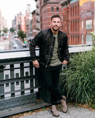 How to wear: black satin bomber jacket, olive crew-neck t-shirt, black skinny jeans, brown suede chelsea boots