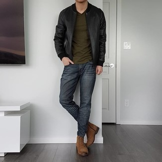 Black Leather Bomber Jacket Outfits For Men: Why not go for a black leather bomber jacket and charcoal jeans? Both pieces are very functional and will look amazing worn together. Why not introduce a pair of brown suede casual boots to the mix for a sense of class?