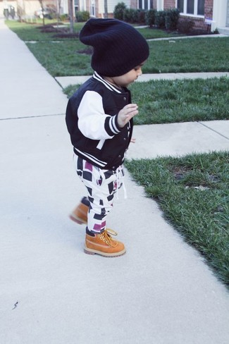 Dress your boy in a black bomber jacket and white and black sweatpants for a fun day out at the playground. As for footwear your kid will love tan boots for this look.
