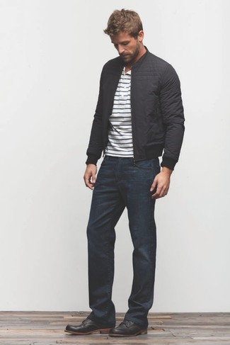 How to wear: black bomber jacket, white and navy horizontal striped henley shirt, navy jeans, black leather desert boots