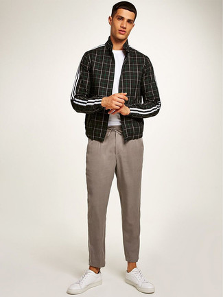 How to wear: black check bomber jacket, white crew-neck t-shirt, beige chinos, white leather low top sneakers