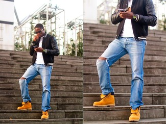 A black leather bomber jacket and blue distressed jeans are your go-to outfit for lazy days. A pair of orange suede casual boots will bring a strong and masculine feel to any getup. With springtime in the air, it's time to sport simple and sharp ensembles, just like this.