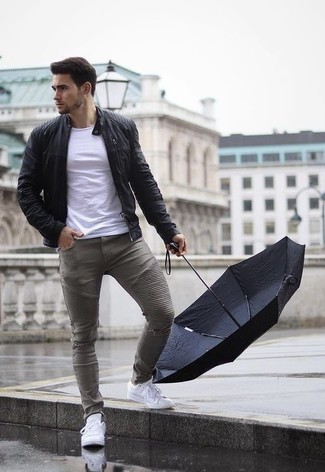 How to Wear White Leather Low Top Sneakers In a Relaxed Way For Men: Wear a black leather bomber jacket and grey ripped skinny jeans to put together a truly sharp and modern-looking laid-back ensemble. Avoid looking too casual by finishing off with white leather low top sneakers.