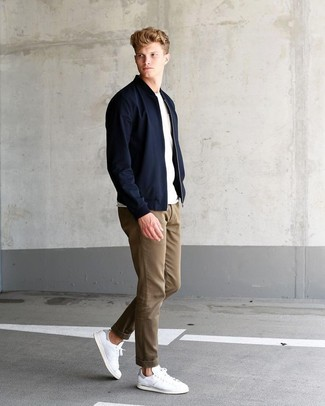 How to wear: black bomber jacket, white crew-neck t-shirt, khaki chinos, white leather low top sneakers