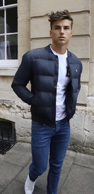 This combination of a black bomber jacket and navy jeans is super versatile and really up for any sort of adventure you may find yourself on. This look is complemented perfectly with white leather low top sneakers. It goes without saying that this one makes for a great, spring-appropriate look.