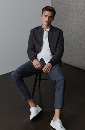 Navy Wool Chinos Outfits: For a casual outfit, pair a black suede bomber jacket with navy wool chinos — these pieces work pretty good together. Introduce a pair of white leather low top sneakers to the equation to immediately turn up the street cred of your outfit.