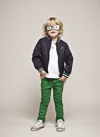 Boys' Looks & Outfits: What To Wear In 2020: Consider dressing your little guy in a black bomber jacket with green jeans for a comfy outfit. This look is complemented well with white sneakers.