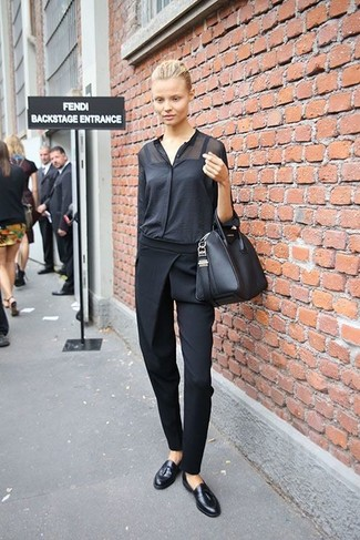 How to Wear a Black Button Down Blouse: Wear a black button down blouse and black tapered pants if you wish to look incredibly stylish without spending too much time. Complement your ensemble with black leather tassel loafers and the whole outfit will come together wonderfully.